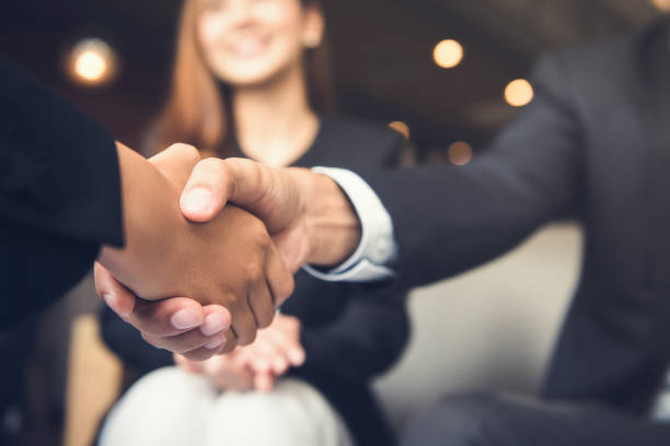 Auto Insurance Broker shaking hand with client